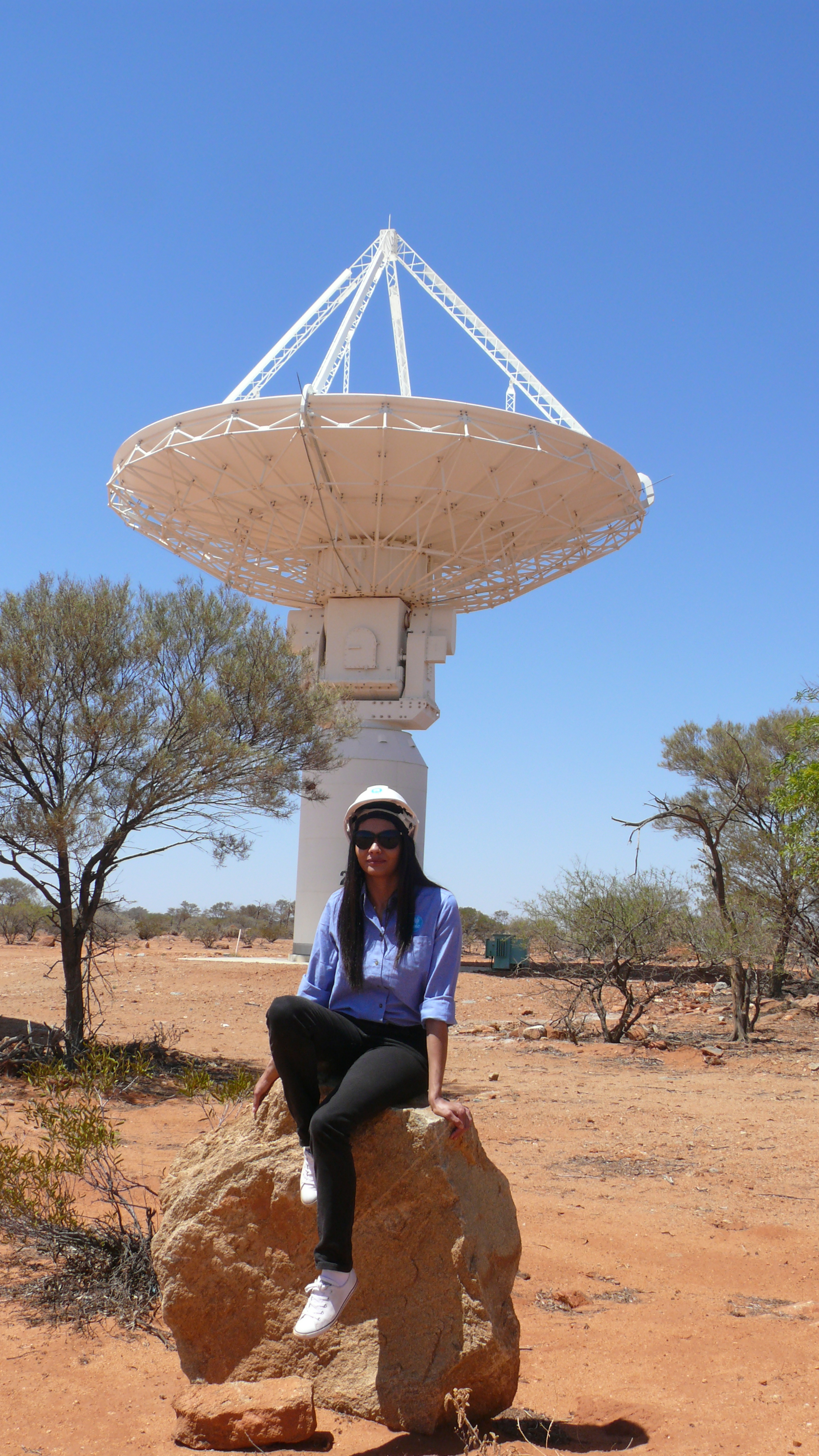 Jayde Clayton enjoying the sun in front of the ASKAP telecsope