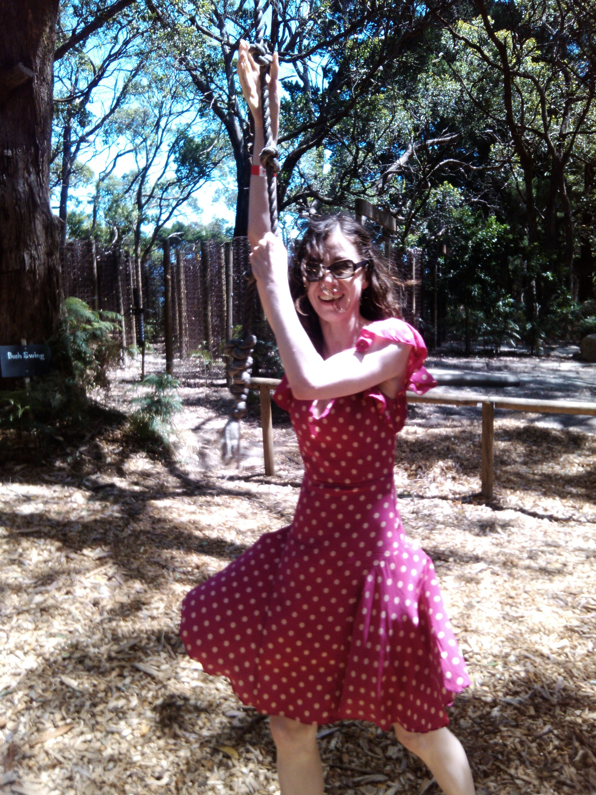 Louise Osborne playing on rope in the bush
