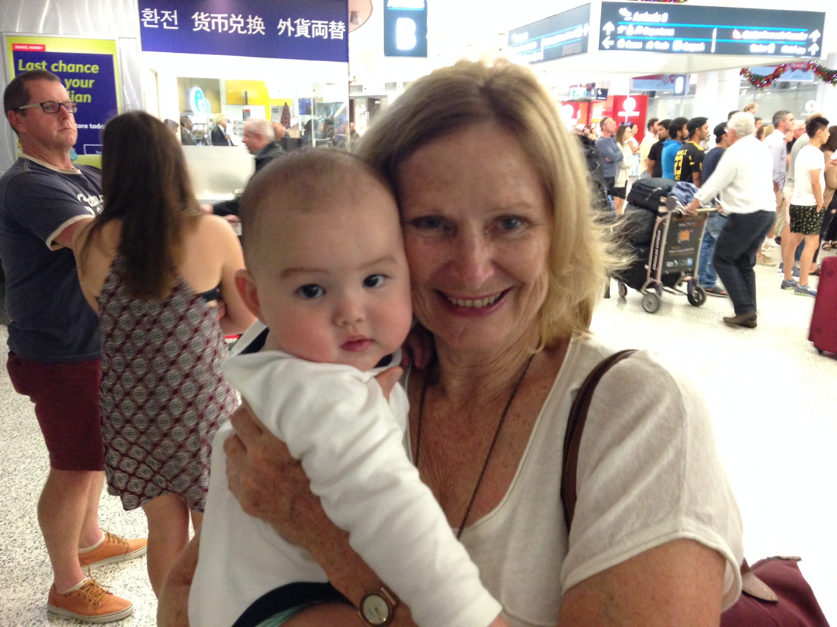 Maxine McCall holding baby at the airport