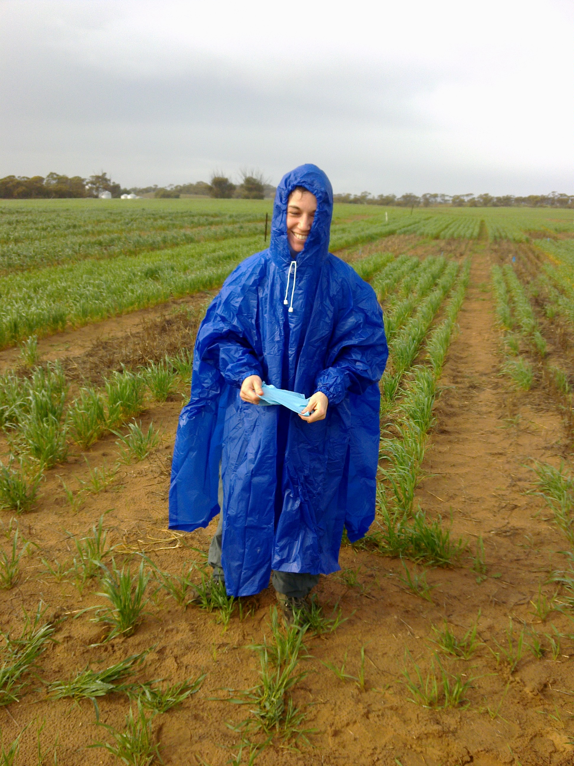 Pilar Muschietti in poncho outside in field