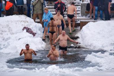 Men walking into ice bath.