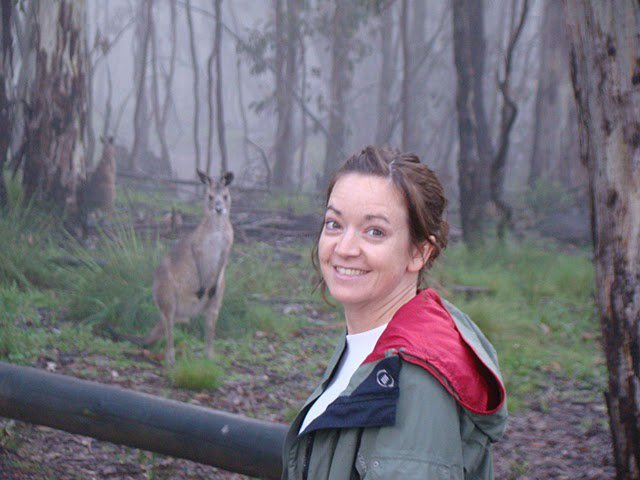 Jenny Clement in the outback with a kangaroo.