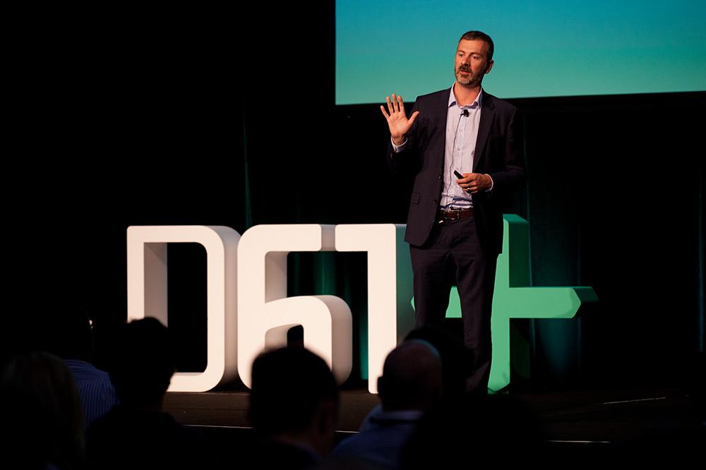 Data61 CEO Adrian Turner presenting