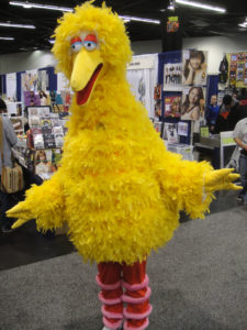 Tall yellow feathery bird suit
