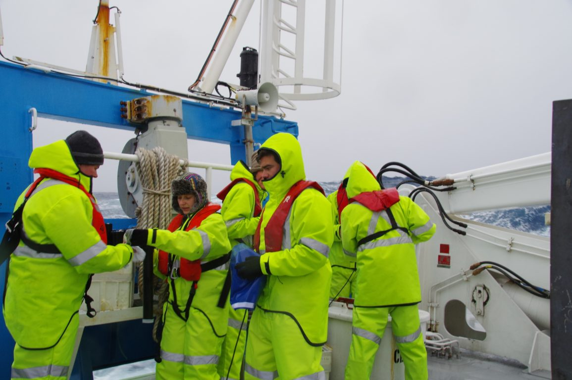 Loading XBTs whilst trying to keep the launcher dry in our (very sexy) heavy duty wet weather gear. Image: Bernadette Sloyan.