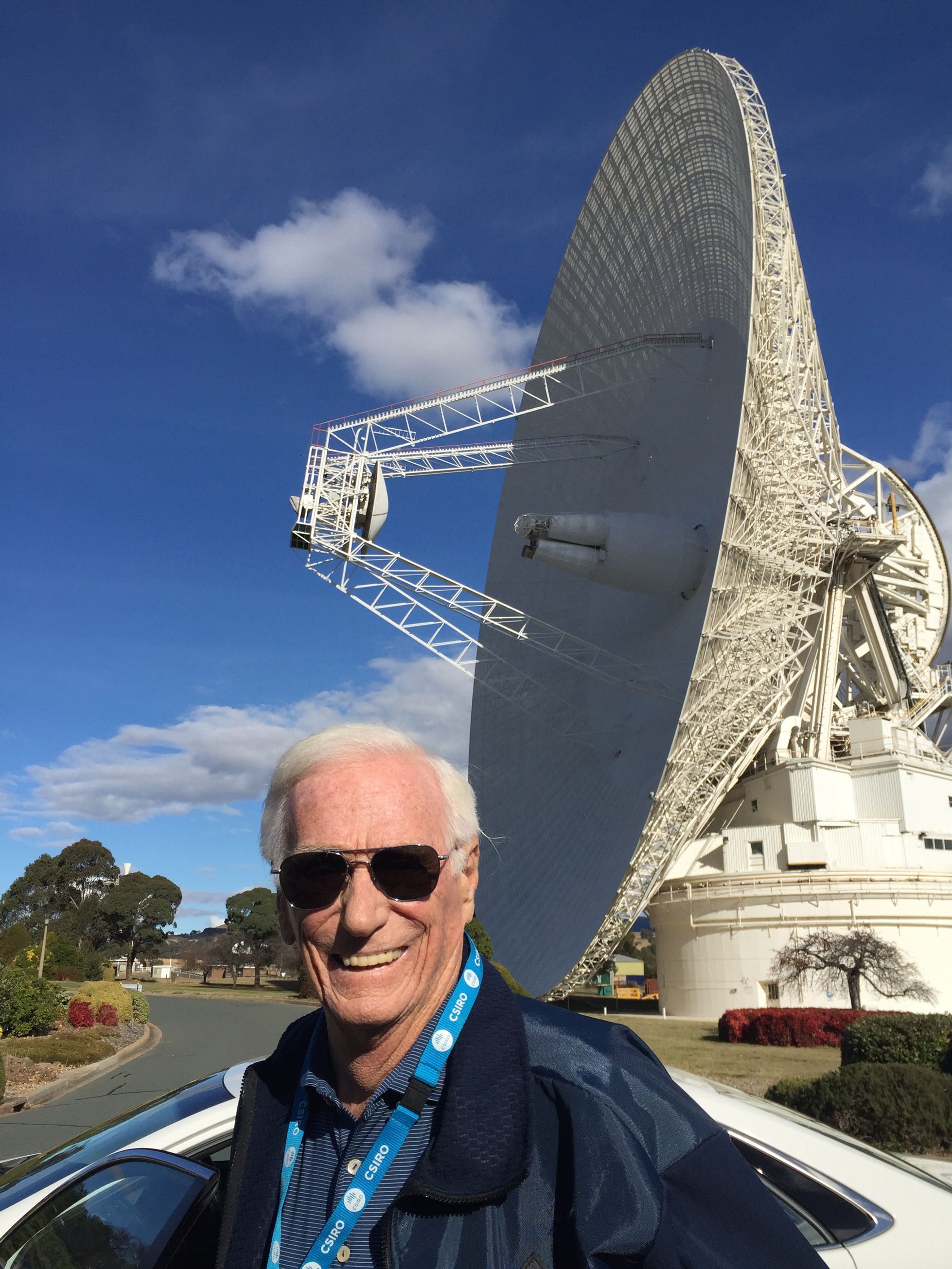 Gene Cernan stands in front of the Parkes dish.