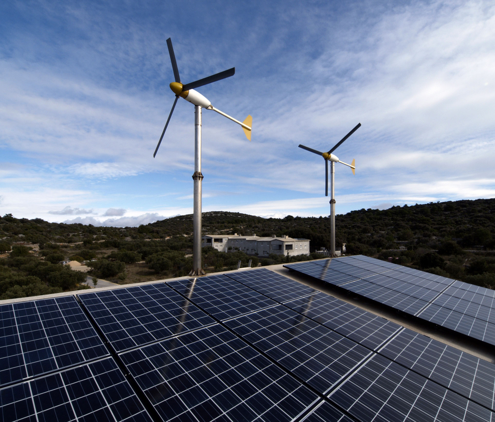 Solar and wind power side by side.