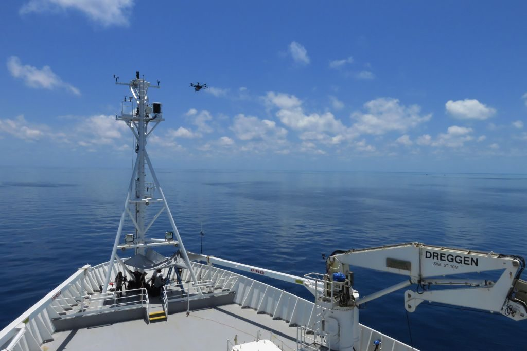 A drone departs Investigator to conduct a close up survey of the reef. Image Michael Watson.