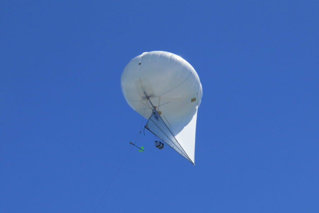 A helium-filled balloon-kite used to gather air samples from up to 1km above the reef. Image Michael Watson.
