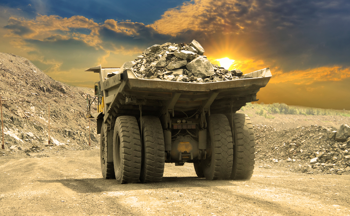 Large mining truck carrying rocks in an open-cut mine