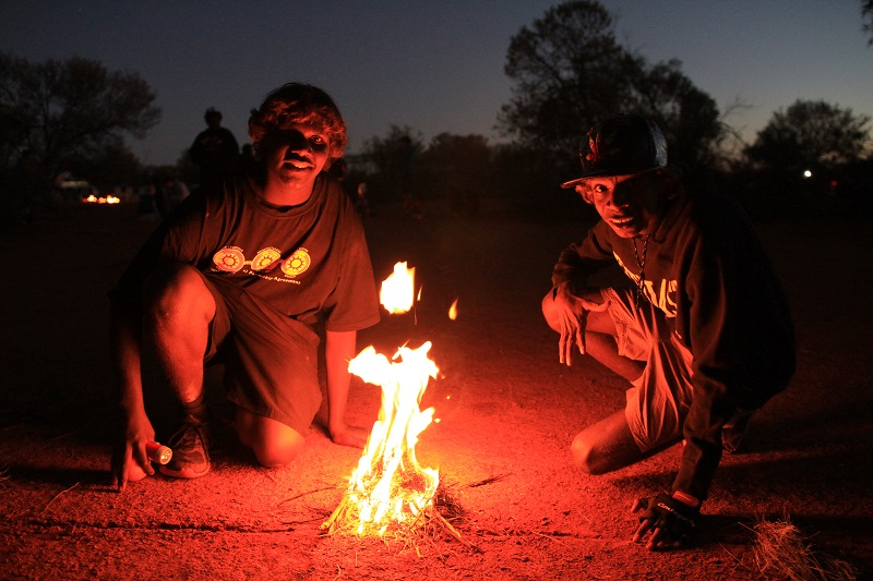 Indigenous students by a camp fire during a Science Pathways trip to the edge of the Gibson Desert
