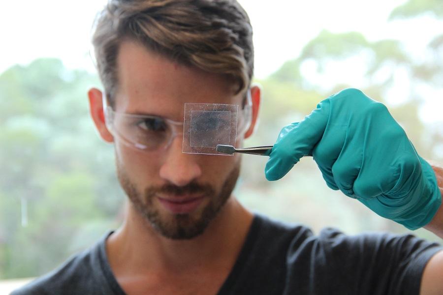 Scientist looking at graphene