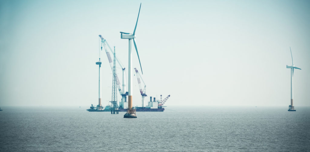The rise of renewable energy is one reason the world is shifting away from coal. Wind turbine image from www.shutterstock.com