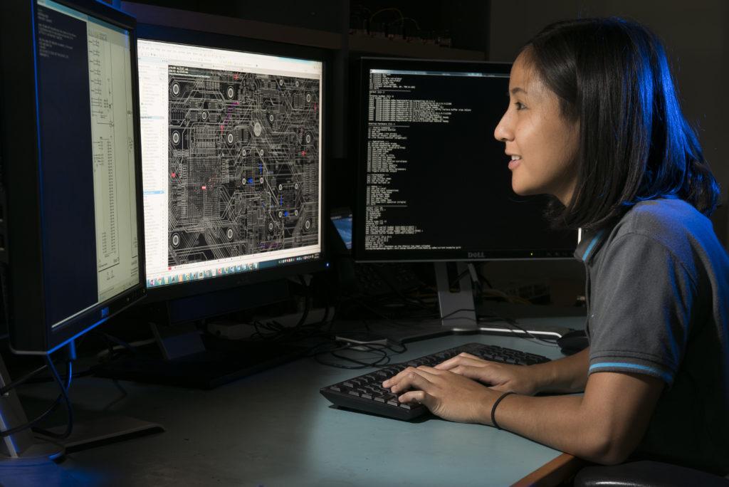 CSIRO researcher Mia Baquiran working on a computer