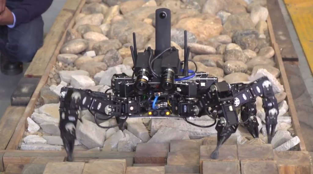 A hexapod being tested on different surfaces