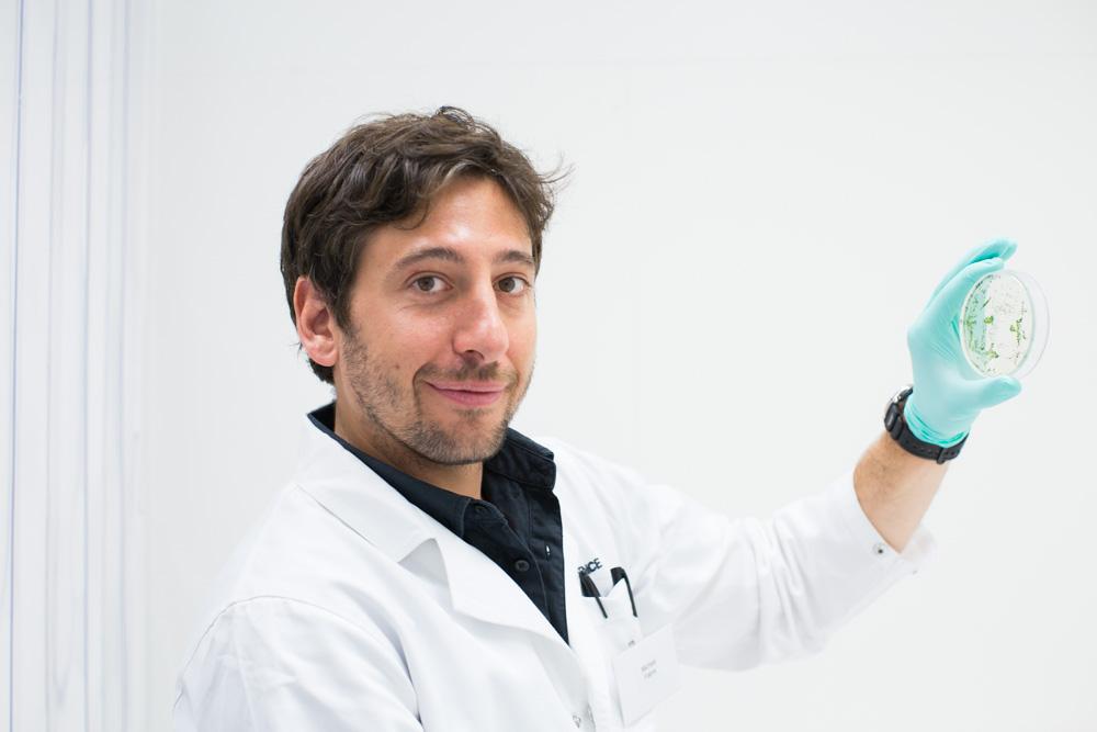 Man with petri dish