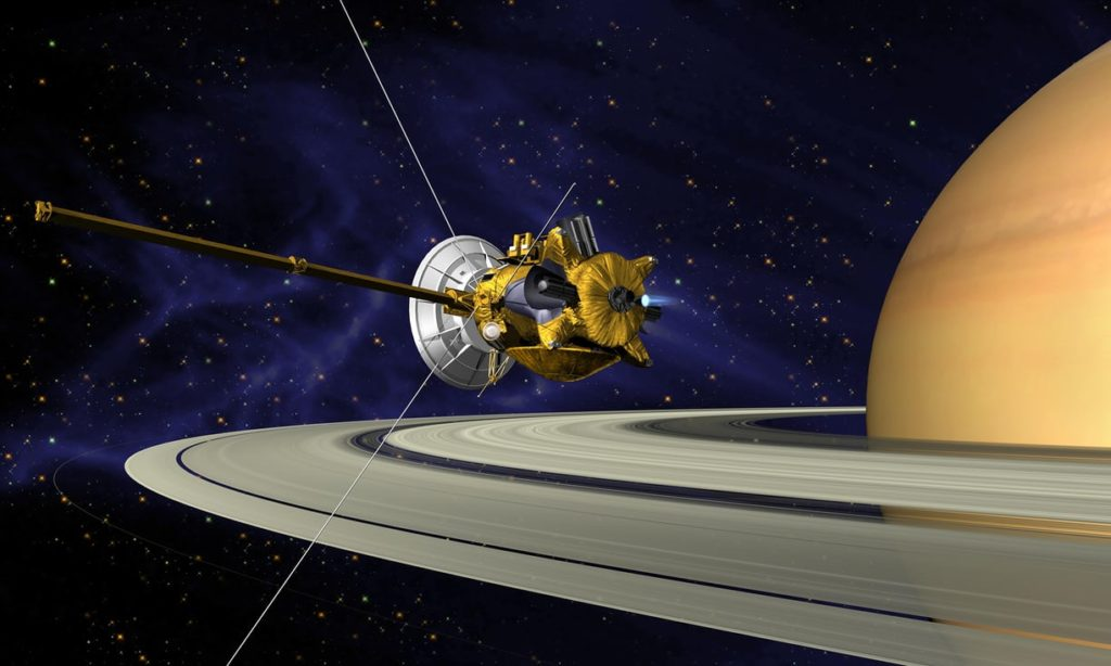 A concept drawing of the probe Cassini near Saturn