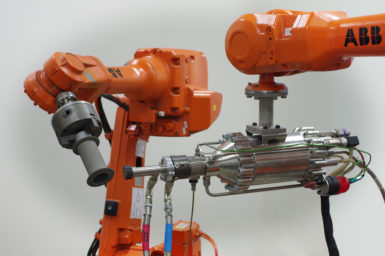 We're using robots to deposit powdered metal onto surfaces faster than the speed of sound.