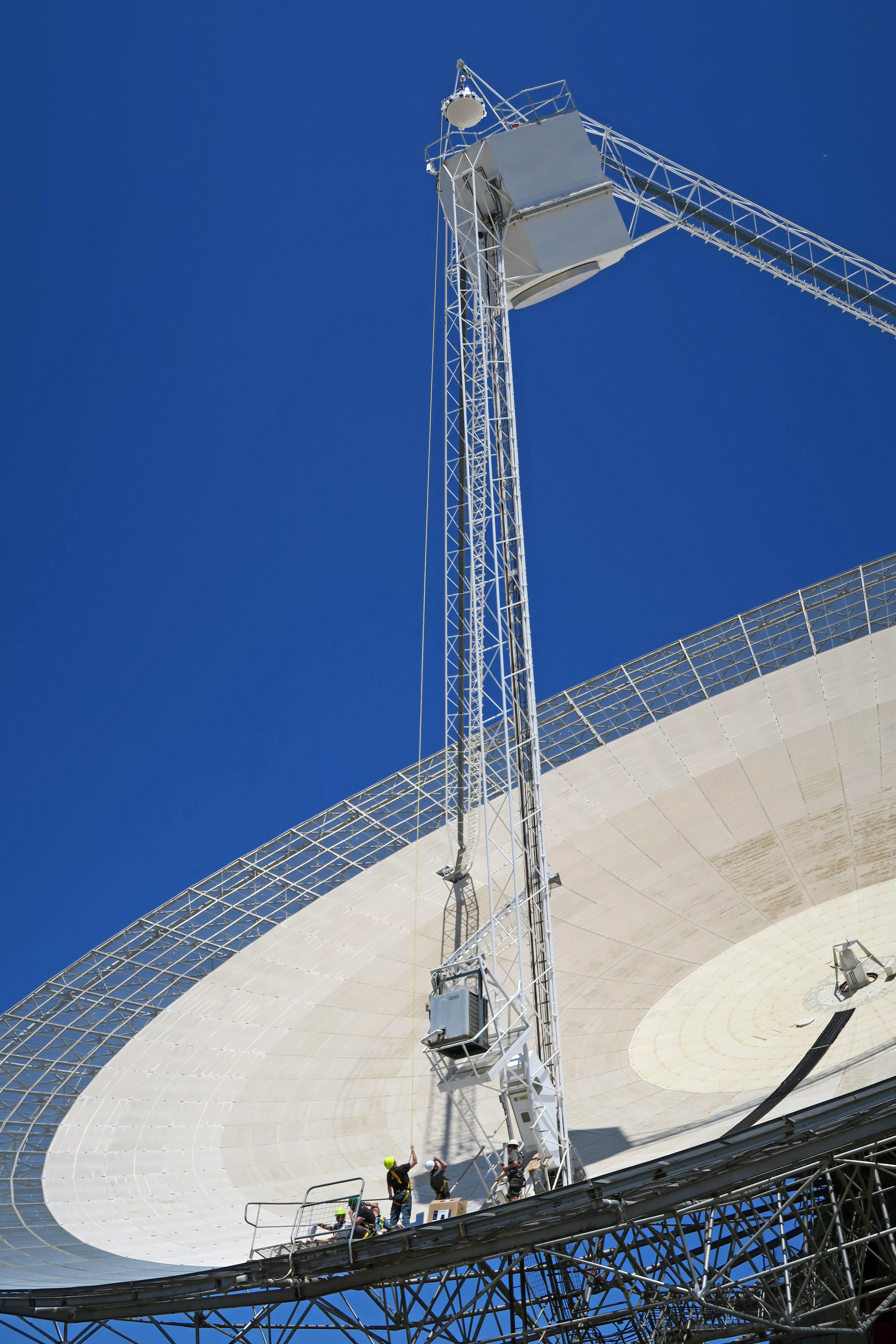 The PAF is hoisted onto our Parkes telescope for testing.
