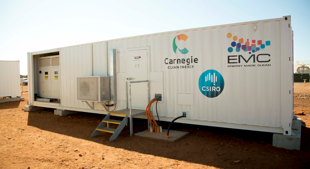 A shipping container customised to shield the battery