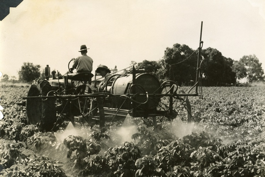 An old agricultural sprayer in a field.