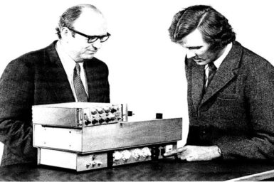 Scientists with an early smoke detector