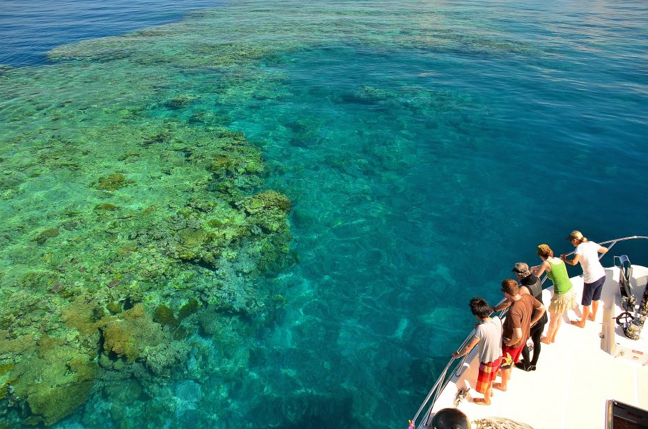 Tourists looking at the Great Barrier Reef from a boat