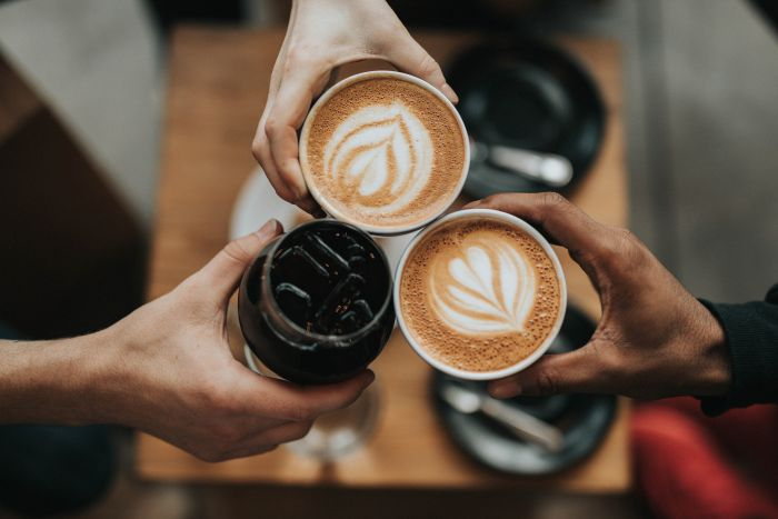 Cheers! Here's to the chemistry behind your morning pick-me-up. Unsplash: Nate Dumlao