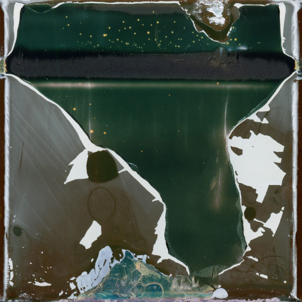 original artwork depicting metallic-like square with jagged white edges, looks to be ripped open to expose under layer of sea green and a powdery looking smudge line across top.