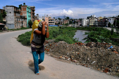 Person carrying container of water