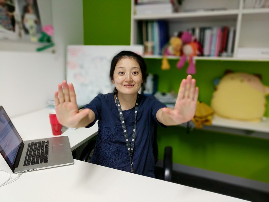 Sherry Xu pushing an imaginary button