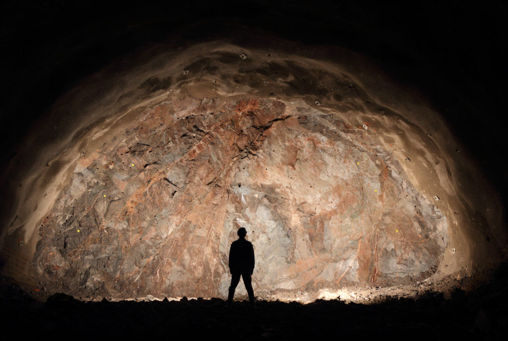 Mine, tunnel front, silhouette of a standing worker
