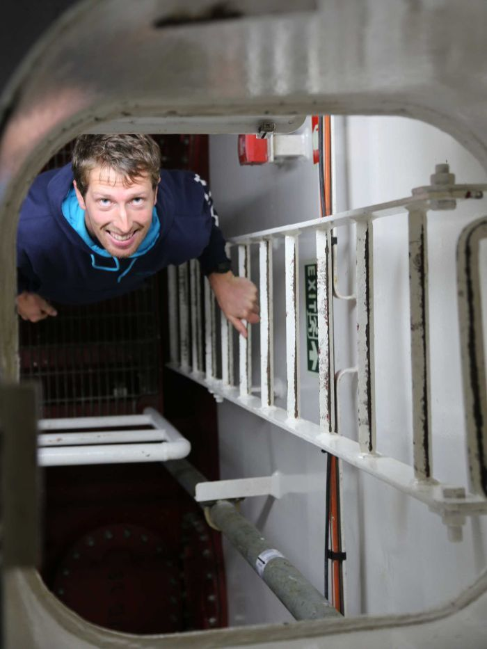 PHOTO: Callum Hollingsworth gets a tour of the ship's engine room. (Supplied: CSIRO)