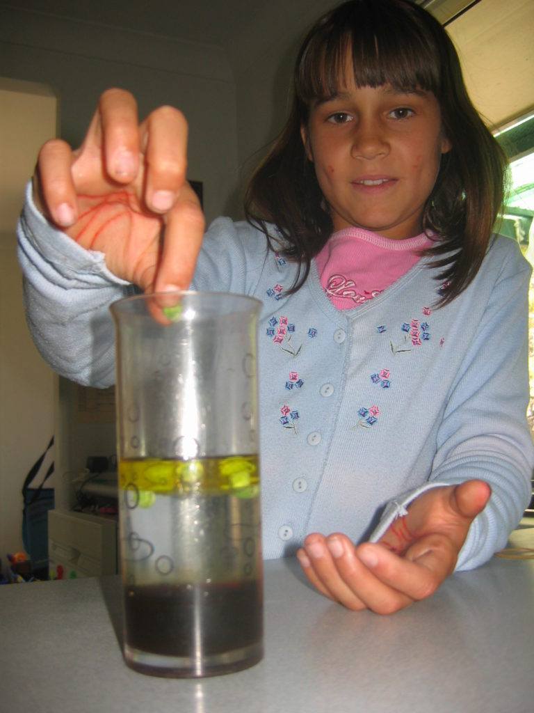 Young girl conducting a science experiment at home