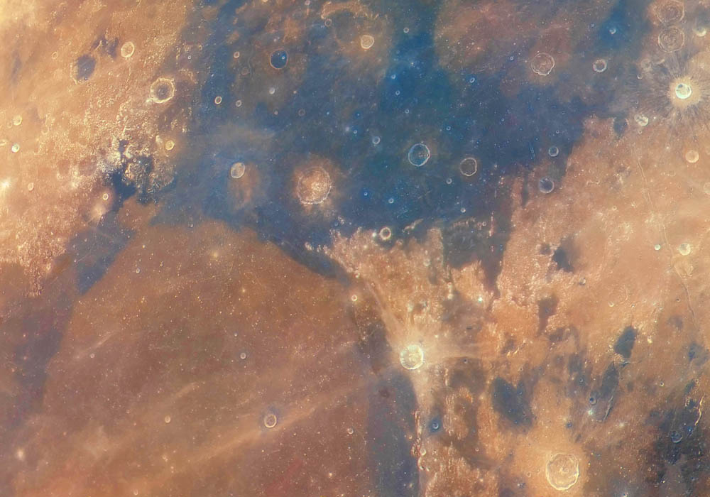 An extreme close up shot of he edge of the seas of Serenity and Tranquility on the Moon in colour.