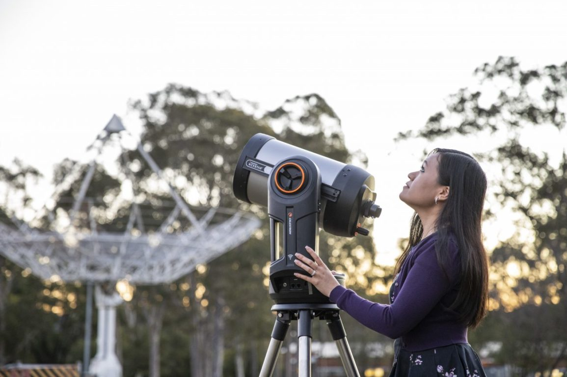 Astronomer Karen Lee-Waddell with telescope