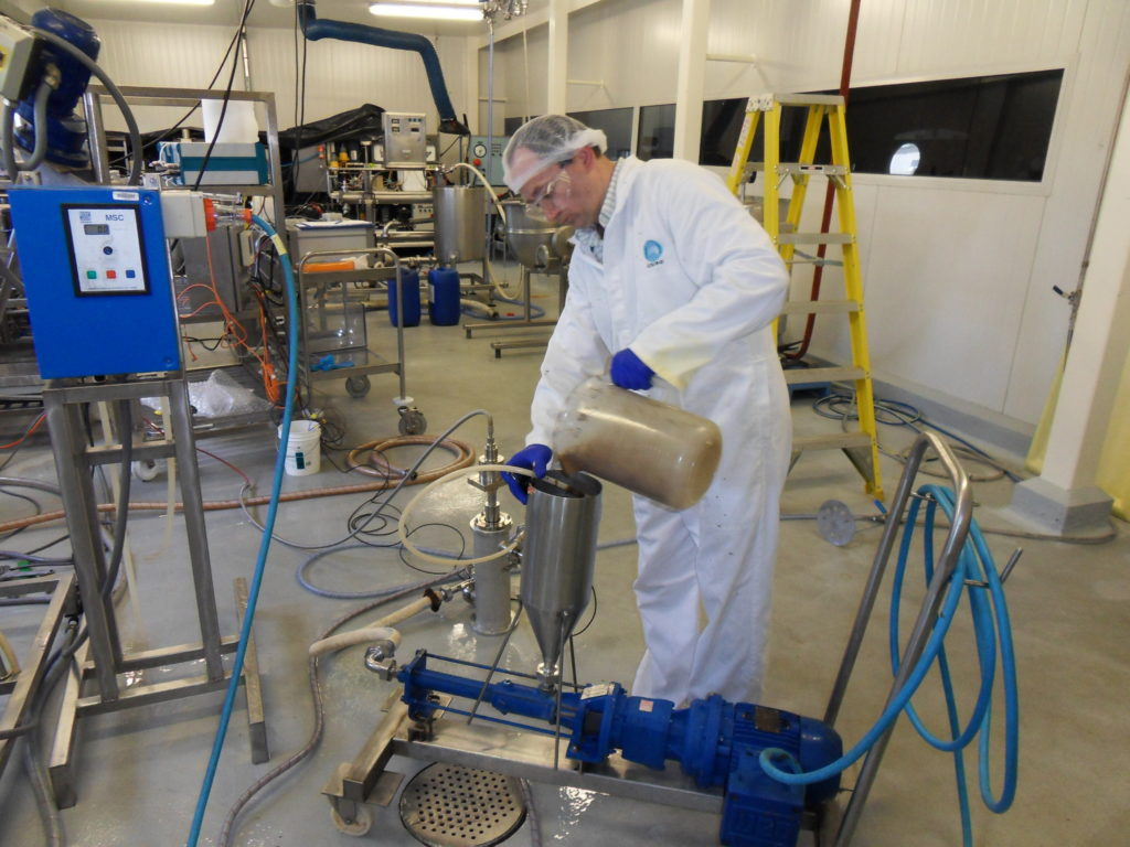 Image of Piotr Swiergon, conducting initial trials of the megasonic vessels in our Food Processing Centre.