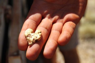 Heart-shaped gold nugget in a hand