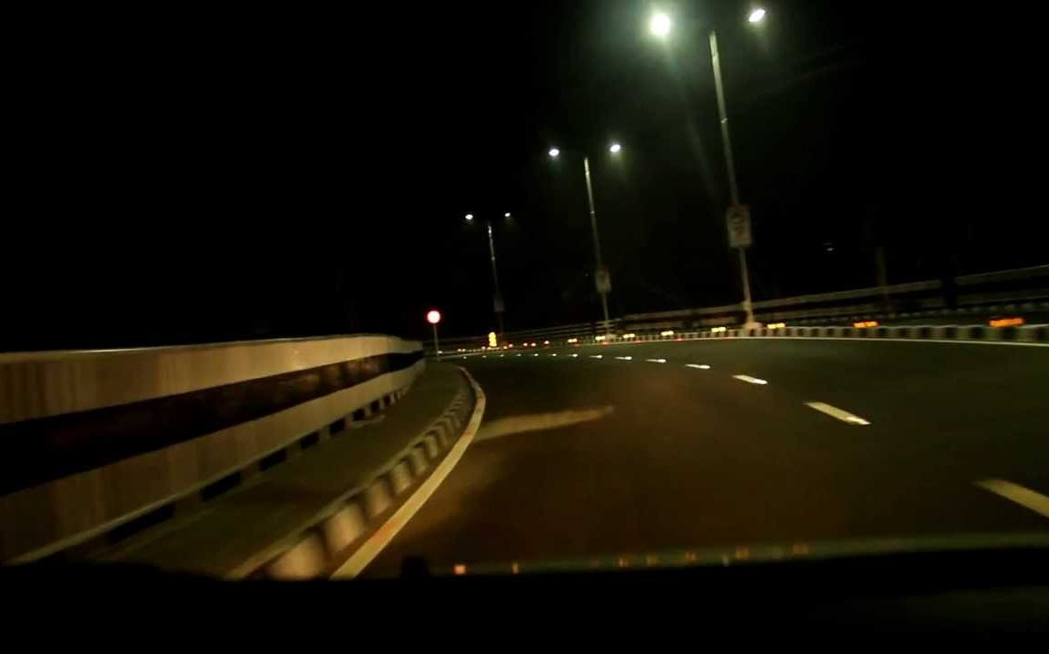 Night time image of road with painted road markings reflected