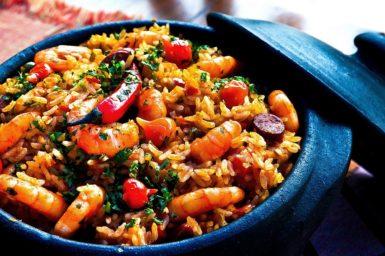 A paella rice dish in a blue pot