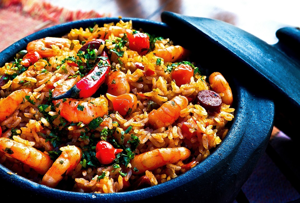 A paella rice dish in a blue pot