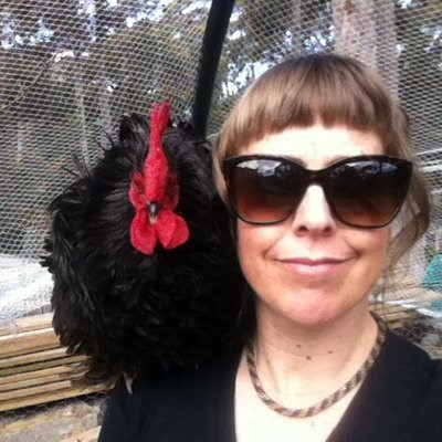 Author Nicole Gill with a chicken on her shoulder