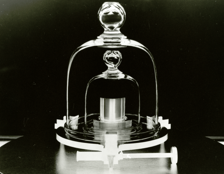 A cylinder of one official kilogram metal within two layers of glass chambers
