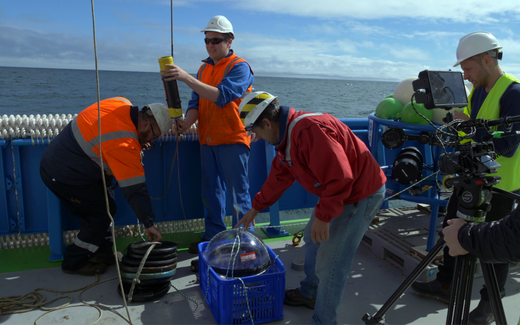Crew with equipment on the research ship RV Investigator