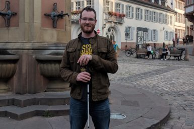 Tim Galvin in Germany in front of a fountain