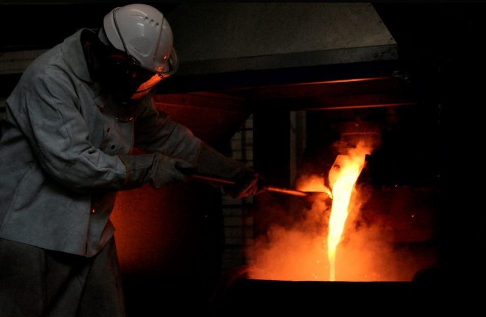 Person smelting phosphate into a 'glassy slag' by-product.