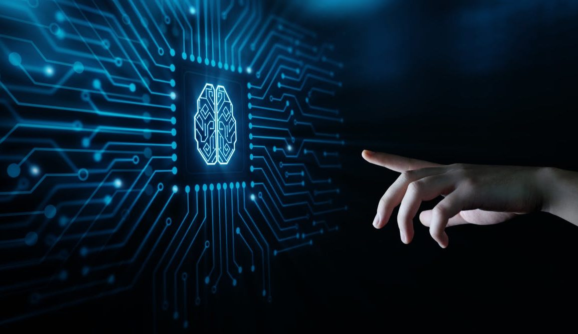 human hand reaching out to computerised image of a brain