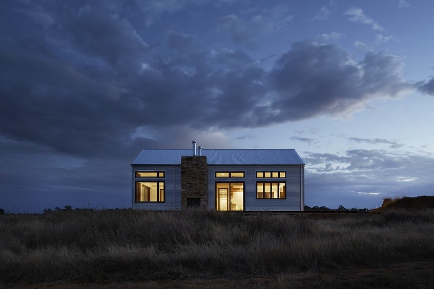 A remote house with lights on