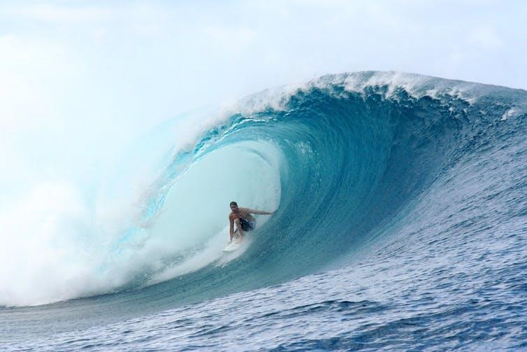 Surfer inside barrel of a wave