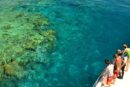 Tourists viewing the Great Barrier Reef from a boat